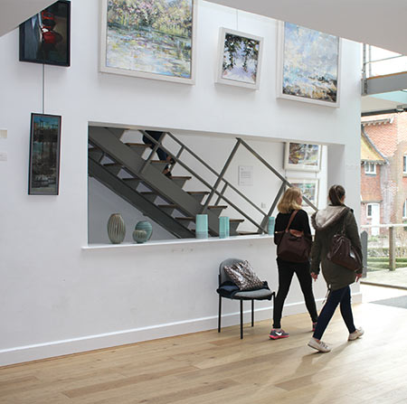 Students walking in the Link Gallery