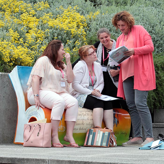 Attendees sat on Jane-Austen themed bench at Winchester Writers' Festival 2018