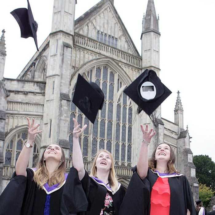 Students celebrating graduation outside the Cathedral
