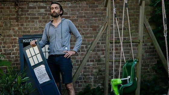 David Tennant, actor who formerly played Dr Who, standing by miniature broken tardis