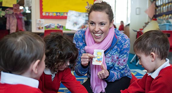 Trainee teacher with children