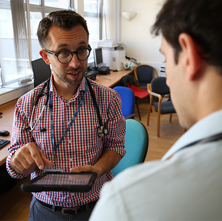 Medical education at Winchester: two men talking, one wearing a stethoscope