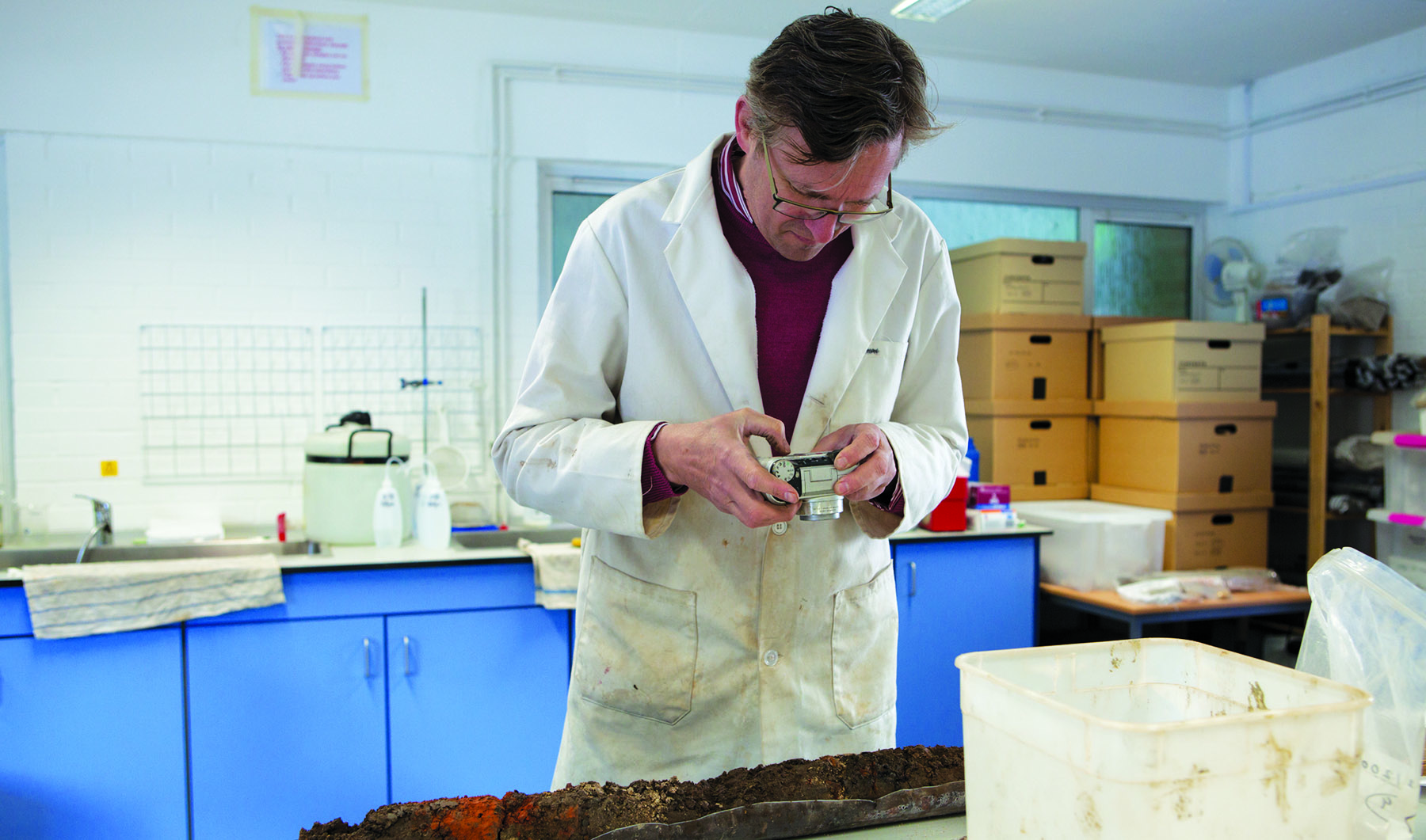 Geoarchaeology at Winchester: Geoarchaeological Consultant Nick Watson photographing a soil sample in the laboratory