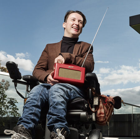 Student on campus with a radio
