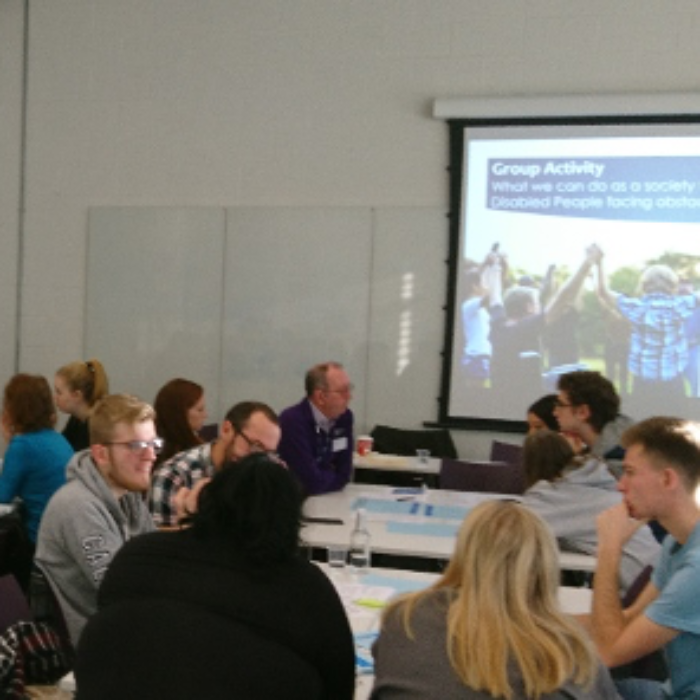 Disability professional lecturing sociology students