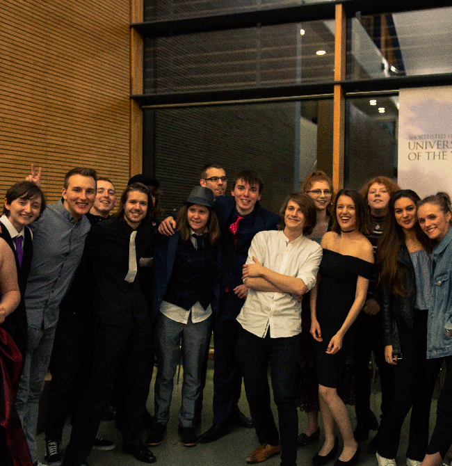 Staff and students celebrating the Creative Writing awards evening